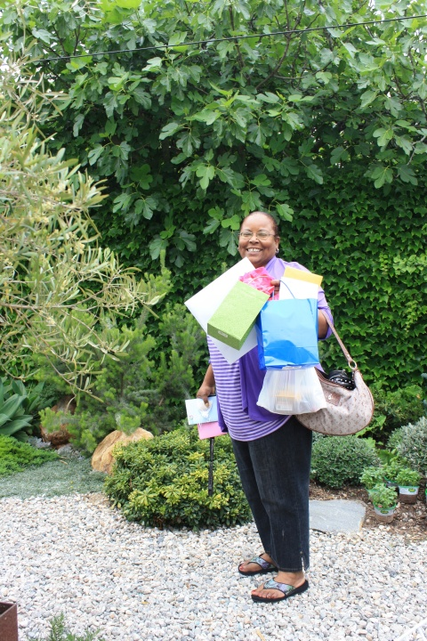 Andre's sister, a mother, too, arrives bearintg gifts. I love all the bright baloon-like colors.