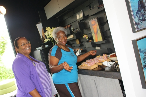Mother and daughter, Anita and Doris in Andre's chic black kitchen.