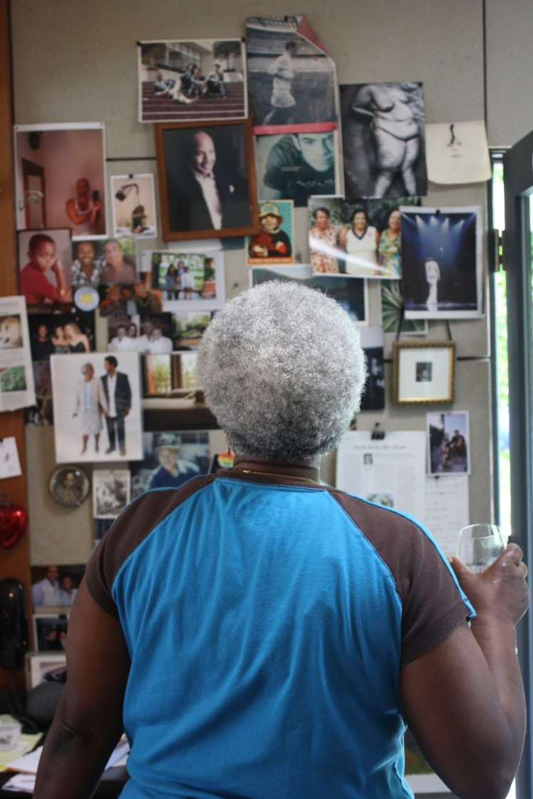 Andre's mother looking at his inspiration board. No pinterest here, but real live push-pins.